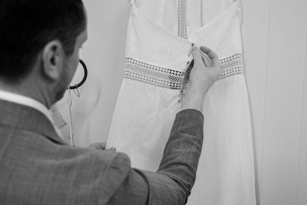 man making a dress black and white scale
